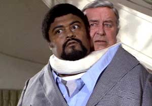 Too close for comfort. Rosey Grier and Ray Milland reluctantly share a body in the Thing with Two Heads.