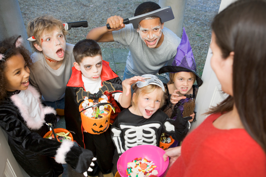 Six children in costumes trick or treating at woman's house