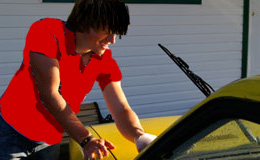 LOVESTRUCK: Young George Kelnway couldn't keep his hands off his yellow Camaro.