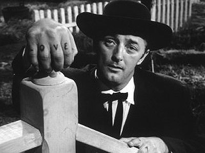"REVEREND HARRY POWELL, played by Robert Mitchum in "" Night of the Hunter"" (1955).As this bogus preacher and serial killer who sports the two words ""LOVE"" and ""HATE"" tattooed across the knuckles of each hand, Mitchum is even menacing here than he was as a rapist stalker in Cape Fear. The charismatic Rev. Powell woos the unsuspecting widow of his former cellmate to get his hands on hidden loot from a robbery. After marrying and murdering her, he relentlessly tracks her two children. The atmospheric film was inspired by the true story of Harry Powers, hanged in 1932 for the murders of two widows and three children in Clarksburg, West Virginia.  Here are two memorable scenes: Sleepless preacher  and Not My Pa. http://www.youtube.com/watch?v=9PyNL2ahKwc"