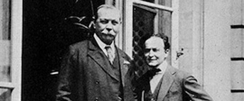 Sir Arthur Conan Doyle, left, and Harry Houdini, were friends--and later enemies.