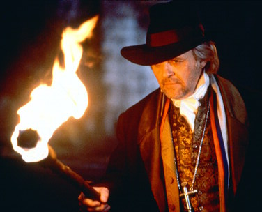 Dr.  VAN HELSING, a role also played by the famous