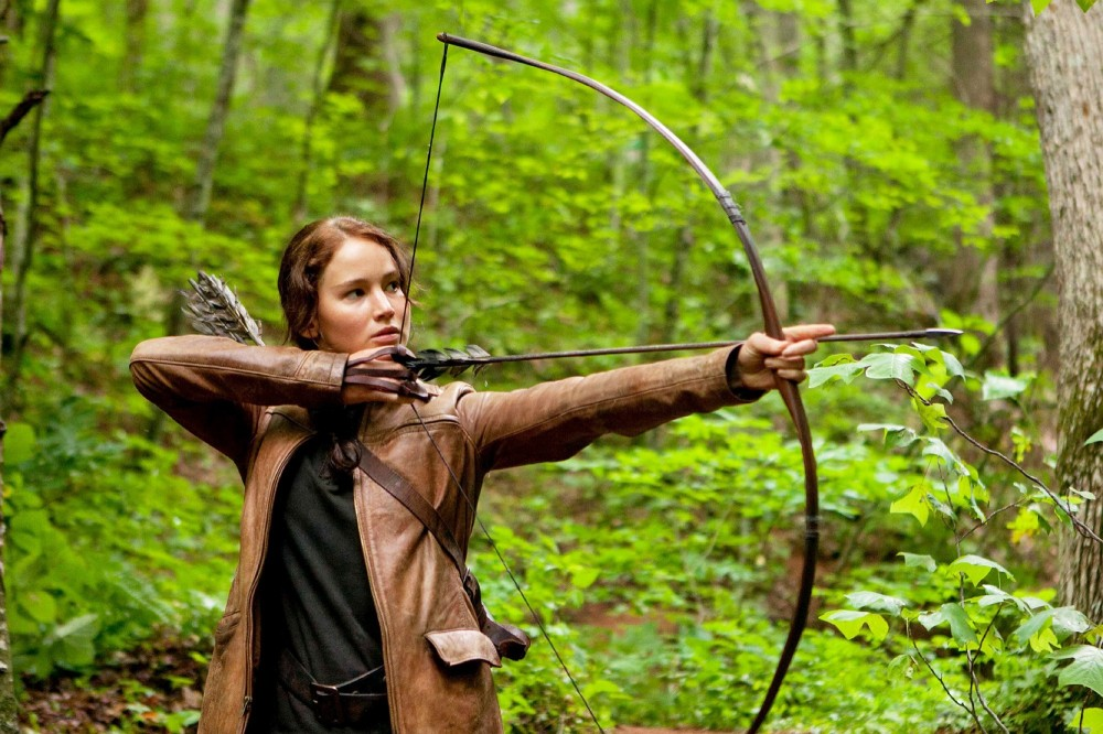 "LIFE IMITATES ART: Concerned NSA officials warn that a rebellious teen might one day lead an uprising against the government, just like Katniss (Jennifer Lawrence) in ""The Hunger Games."""