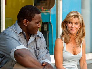 Troubled Michael (Quinton Aaron) finds his life turned around by his white savior played by Sandra Bullock in the hit movie The Blind Side.""